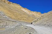 Damaged road in barren mountain — Stock Photo