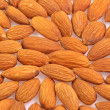 Arranged almonds — Stock Photo