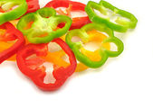 Slices of colorful capsicums — Stock Photo