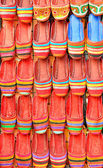 Arranged red hand made shoes — Stock Photo