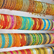 Stock Photo: Rows of colorful bangles
