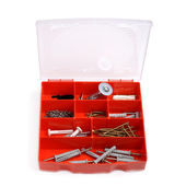 Red box of screws and wall fixings — Stock Photo