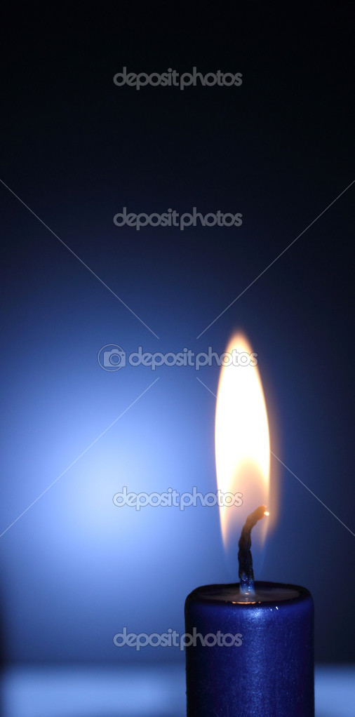 Lit blue candle on the black-and-blue background — Stockfoto #10251919