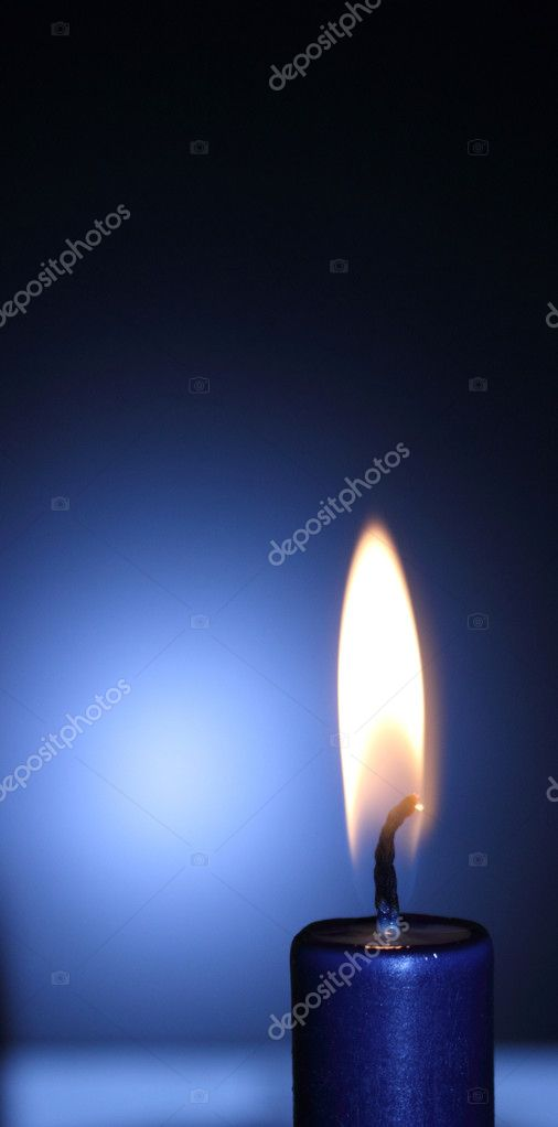 Lit blue candle on the black-and-blue background — Foto Stock #10251919
