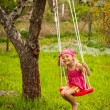 Stock Photo: Little girl with swing.