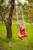 Little girl with swing. — Stock Photo