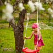 Royalty-Free Stock Photo: Little girl with swing.