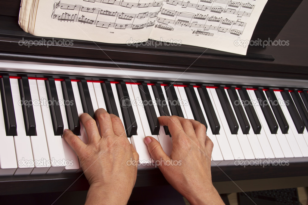 Female hands playing on keyboard — Stock Photo #10553515