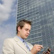 Young businessman with PDA — Stock Photo #10328083