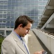 Young businessman with PDA — Stock Photo #10328092