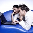 Young couple with laptop — Stock Photo
