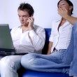 Young couple with laptop — Stock Photo #10328619