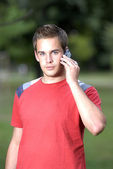 Young man talking on phone — Stock Photo