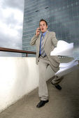 Butterfingers businessman — Stock Photo