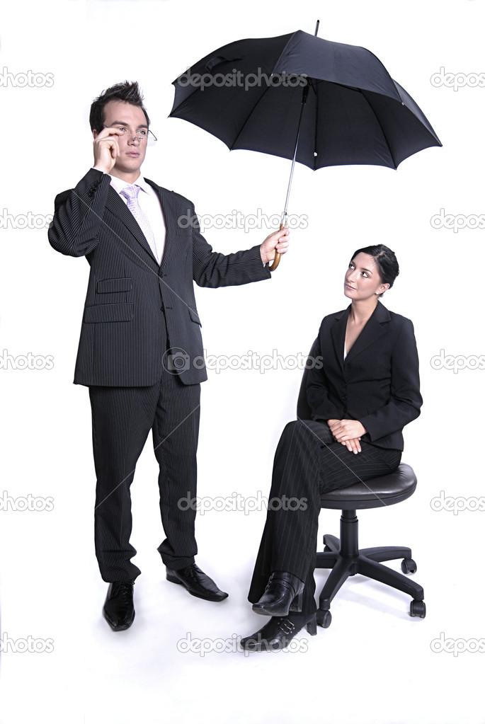 Young couple - successful business team with umbrella isolated on white — Stock Photo #10328487