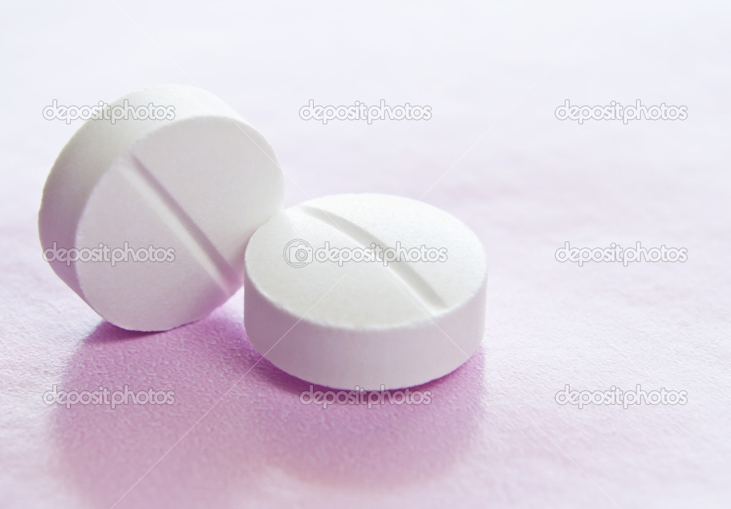 Macro image of two white isolated medicinal tablets. — Stock Photo #10362565