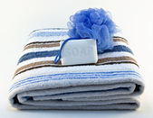 Towel with soap and sponge — Stock Photo