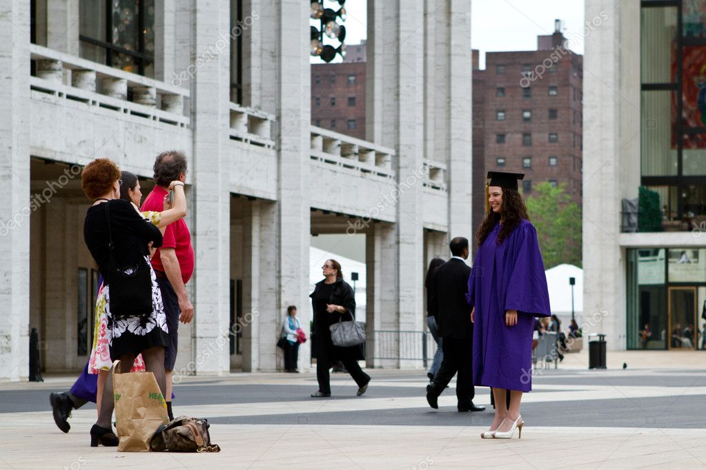 Manhattan, New York - May 19, 2011: Graduate with parents  Stock Photo #10330621