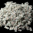 Huge pile of American money on black background - Stock Photo