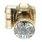 Golden camera with diamonds — Stock Photo