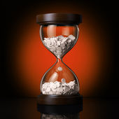 Sand clock with pills — Stock Photo