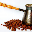 Copper coffee pot with coffee beans — Stock Photo