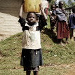 Small african child carrying a jerrycan — Stock Photo #10273228