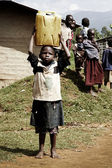 Small african child carrying a jerrycan — Stock Photo