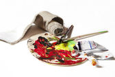 Paintpalette with paint and tubes — Stock Photo
