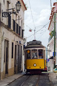 Yellow Tram in narrow street — Stock Photo