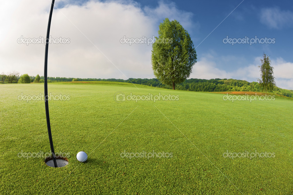 Golf ball near hole on golf course — Stock Photo #10522887