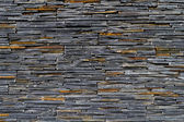 Texture of a wall with flat stones — Stock Photo