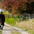Farmer walking on farm in Autumn — Stock Photo