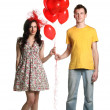 Stock Photo: Boy and girl with balloons