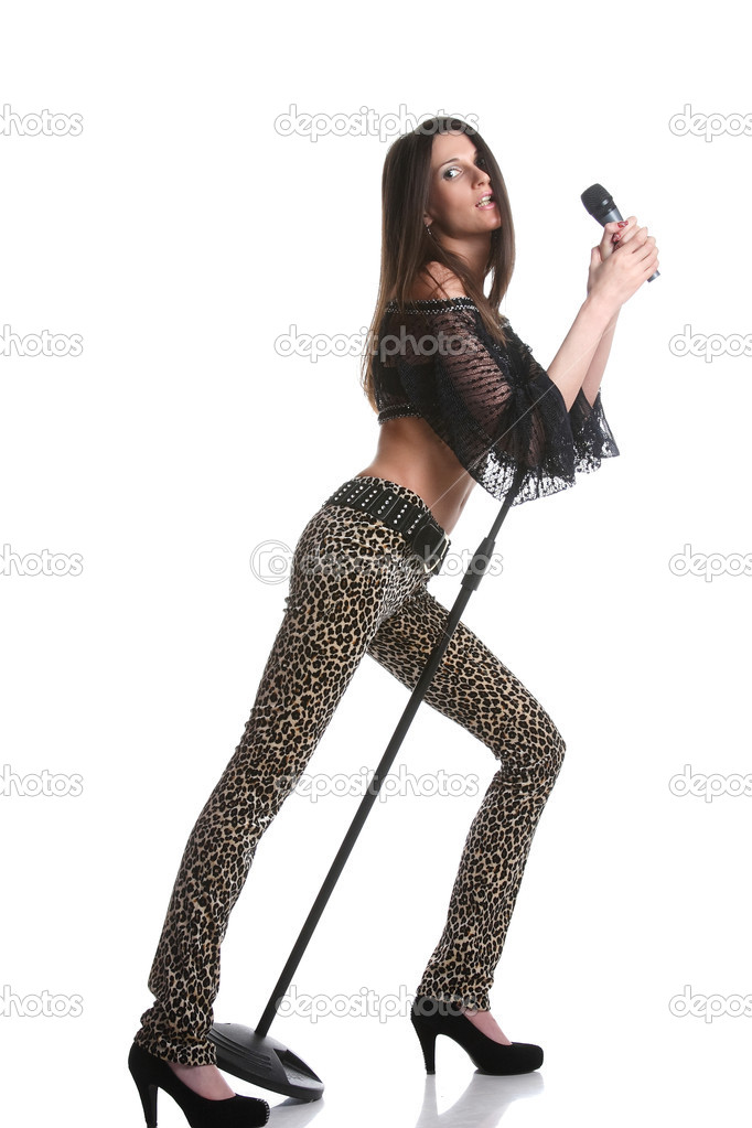 Portrait of a young singer with a microphone — Stock Photo #10455375