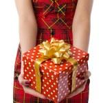 Woman showing beautiful red gift box in closeup — Stock Photo #10343284