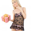 Beautiful girl in sexy pink lingerie with gift box — Stock Photo #10474369