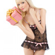 Gorgeous girl in sexy pink lingerie with gift box — Stock Photo #10474404