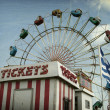 Ticket booth and ferris wheel - Stock Photo