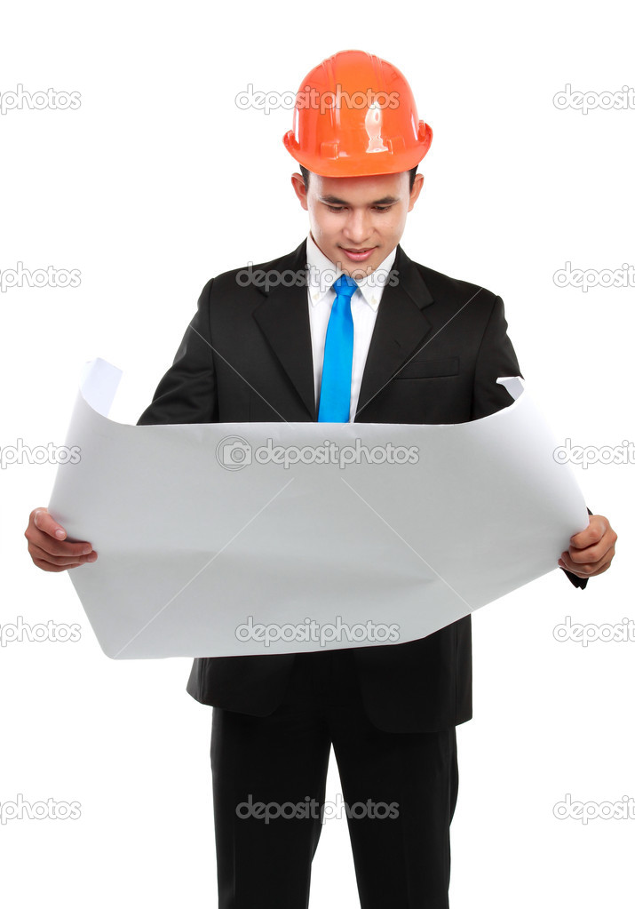 Confident Handsome young asian man architect looking at paper work isolated over white background — Stock Photo #10350815
