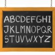 Letters of English alphabet capital upper case on blackboard — Stock fotografie