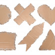 Cardboard with heart, circle, triangle, cross and arrow shape — Stock Photo #10494814
