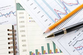 Financial data concept with pen — Stock Photo