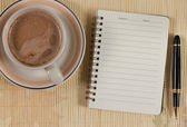 Notebook and coffee — Stock Photo