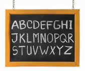 Letters of English alphabet capital upper case on blackboard — Zdjęcie stockowe
