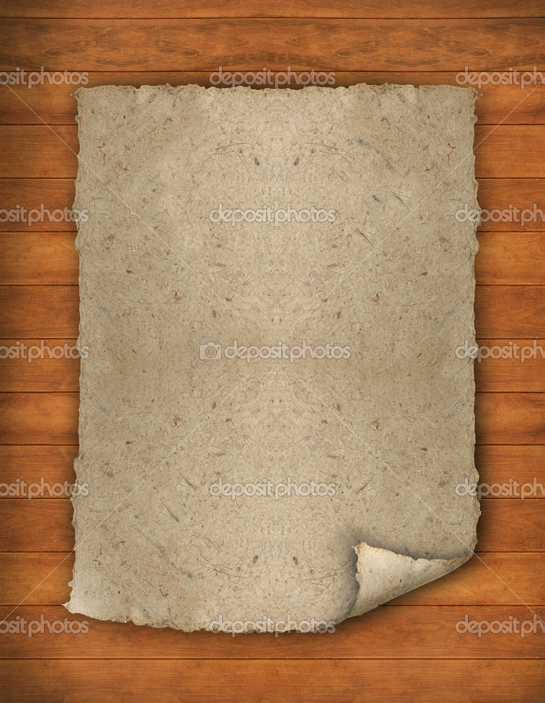 Old paper with corner curl on the wood background — Stock Photo #10494806