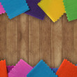 Wood texture with colorful paper — Stock Photo