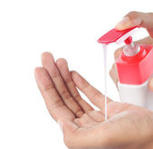Female hands using hand sanitizer — Stock Photo