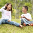 Stock Photo: Two kids outdoor having a chat