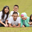 Happy family in park — Stock Photo #10637787